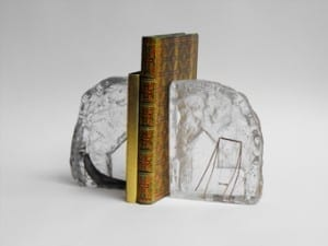 Cast glass memorial bookends with playground scene
